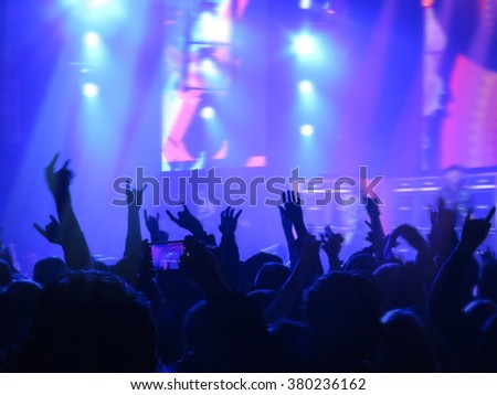 Abstract blurred image. Crowd during a entertainment public concert a musical performance. Hand fans in fun zone people - stock photo