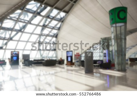 Abstract blurred image of airport interior for background