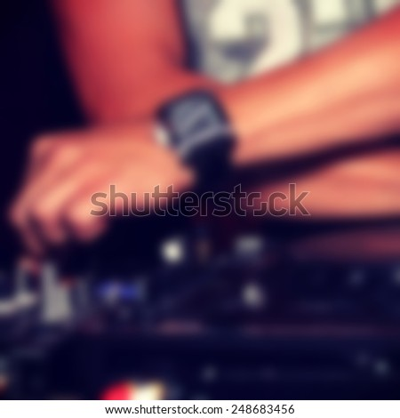 Abstract blurred image of dj as a background for your design - stock photo