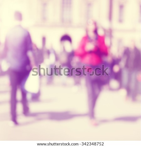 Abstract blurred image of people in the city. - stock photo