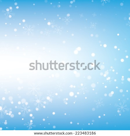 Abstract blurred light on light blue background. Christmas background.