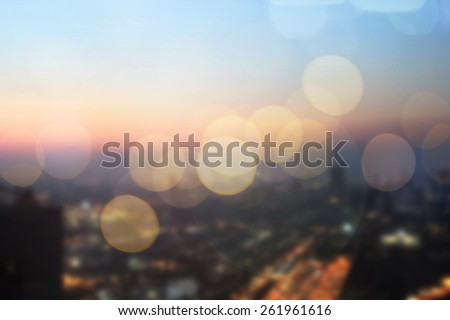 Abstract blurred night city background with circle light. blur backgrounds concept:blur of cityscape in sunset hour wallpaper concept:blurry night urban backdrop.metropolitan city district landscape. - stock photo