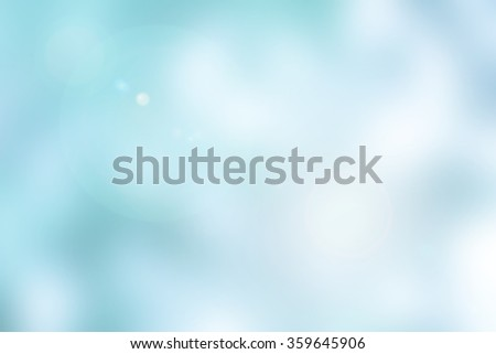 abstract blurred of brightening blue aqua background with flare light:blurry turquoise water surface backdrop for design,decorate,banner:blur ocean sea transparent wallpaper concept:blur picture - stock photo