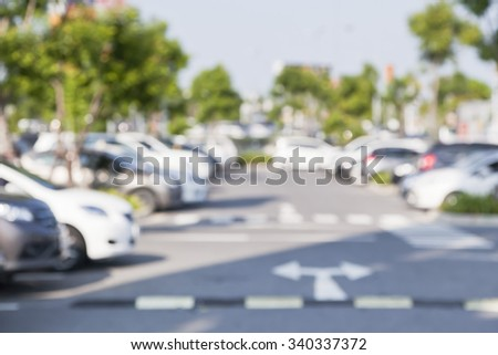 Abstract blurred of car in outdoor parking lot at daytime - stock photo