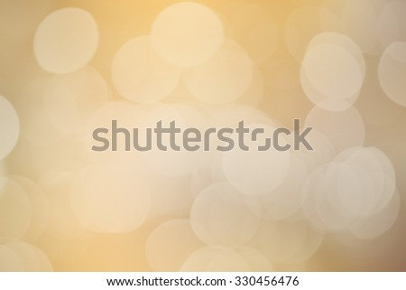 abstract blurred of golden colour backgrounds with circle lights.blur of bokeh circle light christmas festive backdrop concept:blur gold yellow backdrop concept.happy new year card wallpaper.