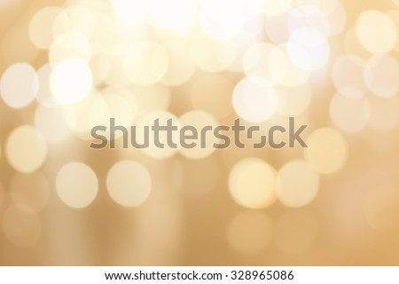 abstract blurred of golden gradient bronze color background with circle lights.blur of bokeh circle light christmas festive backdrop concept:blurry gold metallic yellow texture.glamour royal wallpaper - stock photo