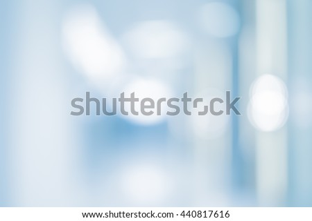 abstract blurred of hospital corridor background:blurry of workplace office in medical clinic backdrop with bokeh circle light:blur of medicine laboratory workshop wallpaper:blurred display conception - stock photo