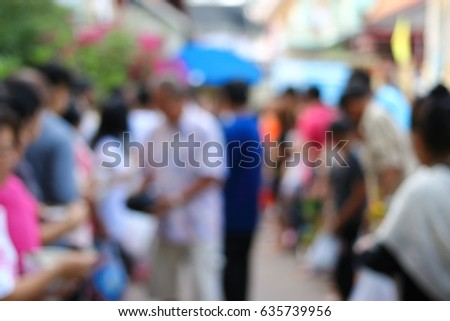Abstract blurred of people line up at temple in Songkran Day.