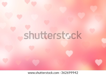 abstract blurred of soft sweet pink background with heart shape bokeh motion:blurry beautiful coral color shiny backdrop with ray flare light for Valentine's day wallpaper display picture concept. - stock photo