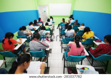 Abstract blurred of young students studying on weekends in a small class of a tutorial school  - stock photo