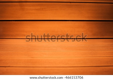 Abstract blurred old orange wood backgrounds and texture closeup, focus on center