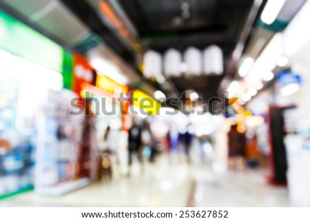 Abstract blurred people in shopping center - stock photo