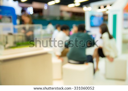 abstract blurred people meeting at house exhibition trade show