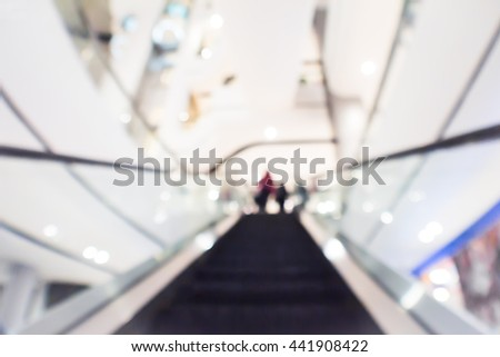 abstract blurred people rushing in the escalator. - stock photo