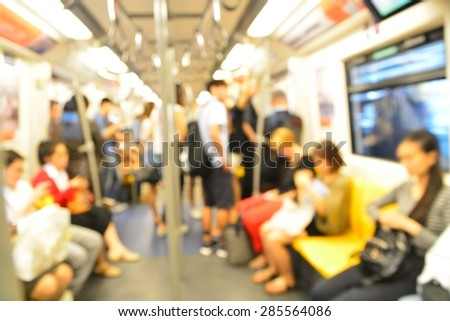 Abstract blurred people standing in electrical sky train - stock photo