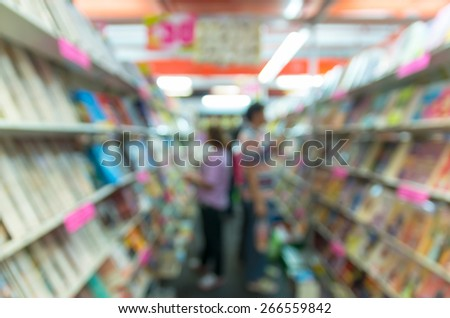 Abstract blurred photo of book store with people background - stock photo