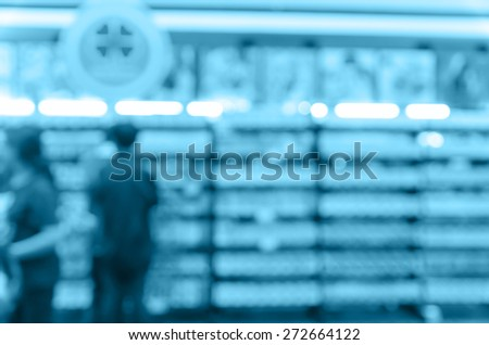 Abstract blurred photo of book store with people background, blue color tone - stock photo