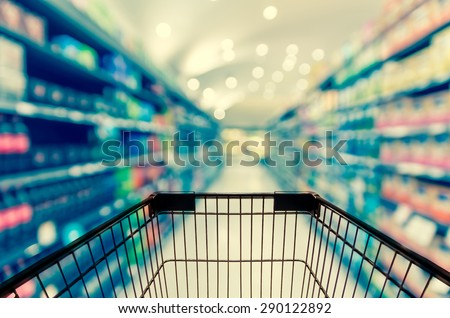 Abstract blurred photo of store with trolley in department store bokeh background - stock photo