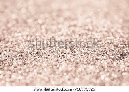 Abstract Blurred pink gold tone lights background design or wallpaper glitter vintage lights texture. silver and white with space. de-focused