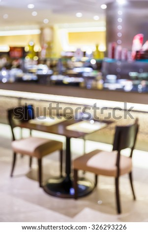 Abstract blurred restaurant or food center with light bokeh background, party lifestyle - stock photo