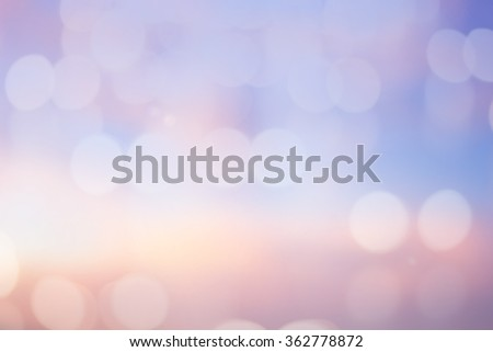 abstract blurred sunset background with circle lights in pastel color tone color.blur of bokeh sparkle of Christmas backdrop concept.blurry glitter shine decoration banner template:sunshine of summer. - stock photo