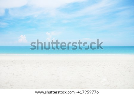 Abstract blurred surfing wave on summer ocean beach background. Blue water and sky bright. Nature wallpaper blur of sea daytime. View outdoor window. - stock photo