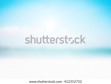 Abstract blurred surfing wave on vacation summer ocean beach background . Blue water and sky bright. Nature wallpaper blur of sea daytime. View outdoor window. - stock photo