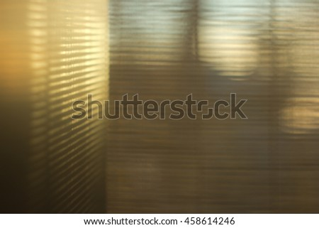 Abstract blurred texture - light flashes  through blinds. Selectiive focus. - stock photo