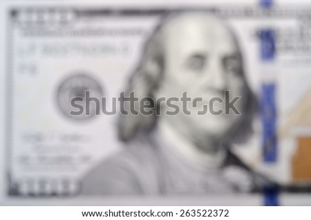 Abstract blurred unfocused United States one hundred-dollar bill ($100) as background - stock photo