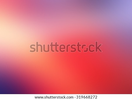 Abstract blurry background in red, orange and purple tones and colors. - stock photo