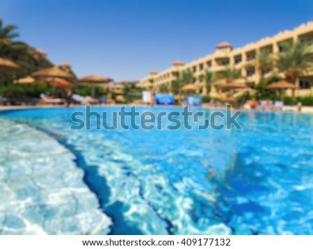 Abstract blurry beautiful luxury swimming pool in hotel resort