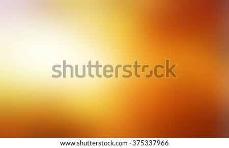 abstract blurry gold background with bright light leak or sunspot flare, abstract smooth textured bright orange brown and gold color, blurred gold background - stock photo