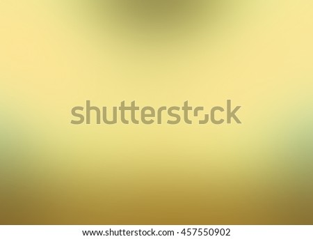 abstract blurry gold background with bright light leaks, abstract smooth textured bright yellow green color, blurred gold background - stock photo