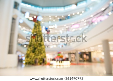 Abstract Blurry or Defocus Background of Shopping Mall with Christmas Tree with Light Decoration - stock photo