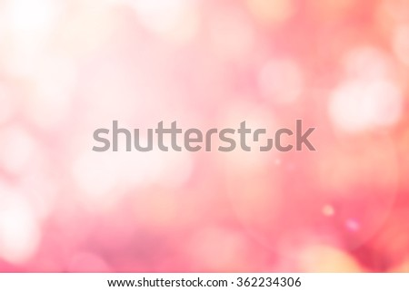 abstract blurry soft pink bokeh sparkle foliage nature background:blurred vintage tone of sweet backdrop with lens flare light:glowing circle round light wallpaper for valentine's day of love concept  - stock photo