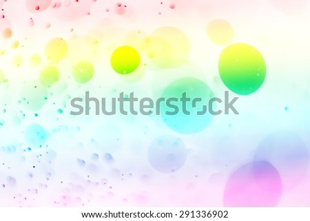 Abstract bokeh background created by light and water spray in rainbow color. - stock photo