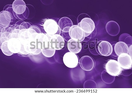 Abstract bokeh background on purple background