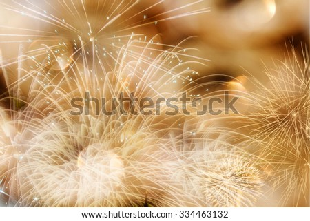 Abstract bokeh holiday background with fireworks and stars - stock photo