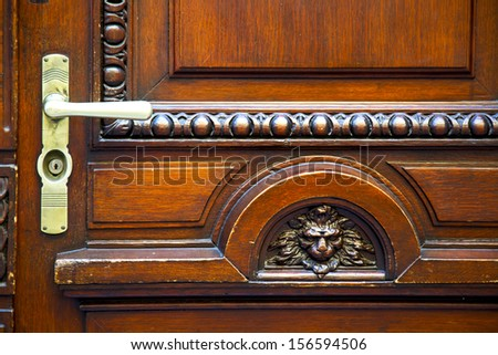 abstract   brass brown knocker in a   closed wood door    lugano Switzerland Swiss  - stock photo