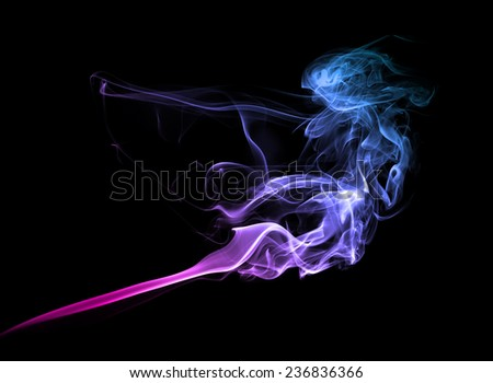 Abstract bright colored smoke on a dark background. - stock photo