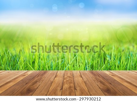 Abstract bright spring with sunlight bokeh background and perspective wooden plank - stock photo
