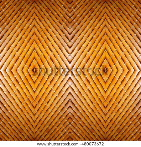 abstract brown or golden bamboo woven texture pattern background,golden bamboo woven background,soft focus image for background.