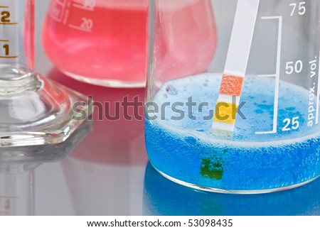 Abstract bubbles of Chemicals reacting with PH indicator (shallow DOF) - stock photo