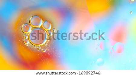 Abstract bubbles of oil on water - stock photo