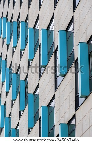 Abstract building exterior with blue frames  - stock photo