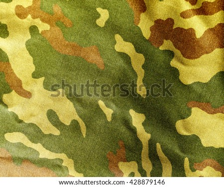Abstract camouflage cloth texture. Background and texture for design. - stock photo