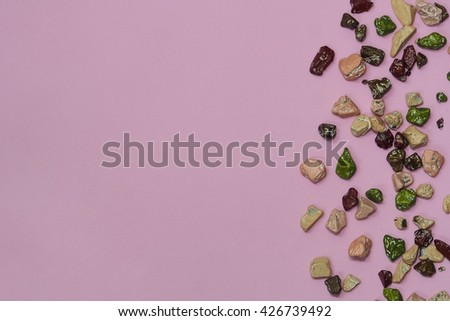 Abstract Candy rocks shape on Pink background and copy space for your text - stock photo