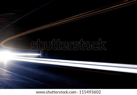 Abstract car lights in a tunnel in white. Picture taken with long exposure