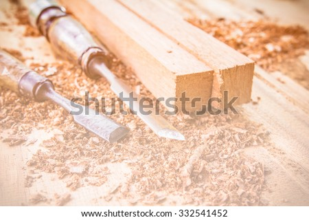 Abstract carpenter tools in pine wood table. made with color filters,blurred focus. - stock photo