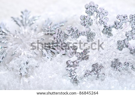 Abstract Christmas background with snowflakes. Shallow depth of field, blue tinted